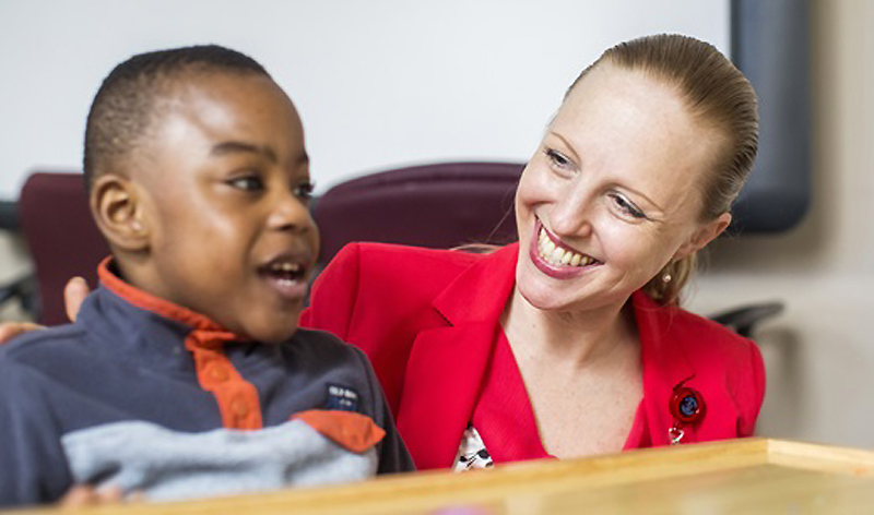 A child in our behavioral health clinic interacts with a caretaker